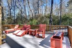 Deck with Adirondack chairs in winter