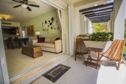Put your feet up in this ground floor condo with pool view