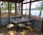 Four season porch with table for meals with a view