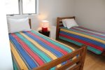 Upper level fiesta stripe twin room.
