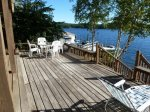 Spacious lower level porch with waterfront access.
