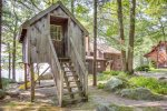 The awesome tree house is a perfect hideaway for kids.