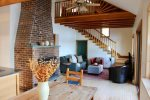 Enjoy the wood fireplace in the colder months, the high ceilings keeping the house warm and airy