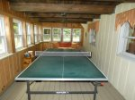 Ping pong table in the lower floor enclosed porch