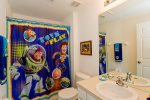 Bedroom 3 includes a private bathroom with Toy Story decor