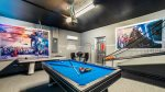 Star Wars themed game room with pool table, air hockey and basketball game