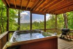 Outdoor hot tub on covered deck