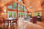 Beautiful vaulted ceilings wil a larger picture of living room