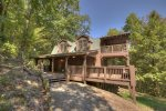 Large covered deck with patio furniture.