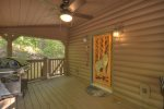 Large open firs floor deck with built in seating and hot tub.