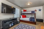3 beds in bunk room Twin bed tops, two full and one queen lower