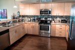 spacious fully furnished kitchen with stainless appliances