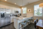 Fully equipped kitchen with S/S appliances and granite counters