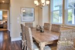 open concept dining area with 6 chairs