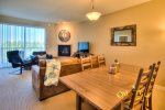 open concept kitchen, dining with seating for 4, and living areas