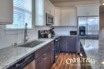open concept fully furnished kitchen with stainless appliances
