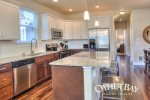 Large fully equipped kitchen with granite counters and stainless appliances