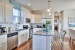 beautiful fully furnished kitchen with stainless appliances