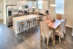 open concept dining with seating for 6 and fully furnished kitchen