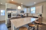 fully furnished kitchen with stainless appliances
