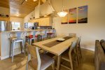 Open concept throughout breakfast bar off the kitchen with seating for 4