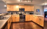 fully furnished open concept kitchen with stainless appliances