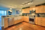 open concept fully furnished kitchen with great bar off kitchen with seating for 4