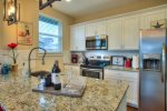 charming fully furnished kitchen with stainless appliances