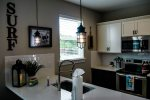 cozy, fully equipped kitchen with stainless appliances