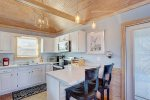Beautiful Kitchen with Vaulted Ceilings and Breakfast Bar