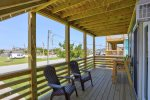 Enjoy the Ocean Breezes on the Covered Deck