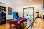 Game room with billiards table, shuffleboard, pac-man, kitchen, and theater-sized screen