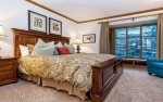 Master suite with king bed and en-suite bathroom.