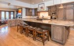 Expansive kitchen with breakfast bar seating for 4 and an additional hearth room.