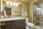 En-suite jr. master bathroom with walk-in shower.
