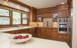 Fully equipped kitchen with additional breakfast bar seating for 3.