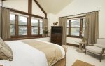 Master suite with king bed, flat screen TV, mountain views, and en-suite bathroom.