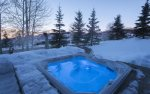 Private outdoor hot tub with mountain views.