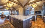 Spacious kitchen with marble counter-tops, state of the art appliances, and fireplace.