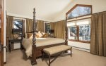 Master suite with king bed, flat screen TV, walk-in closet, and en-suite bathroom.