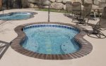 Outdoor pool and hot tubs located just behind the Slopeside condo.