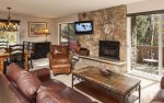 Living room with gas fireplace and flat screen television