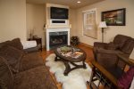 Cozy up in this living room with gas fireplace.
