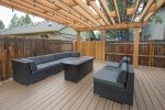 Enjoy this spacious deck all year. Grill or stay warm at the fire.