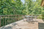Deck with wooded scenic view