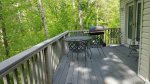 Furnished Deck in quiet wooded setting
