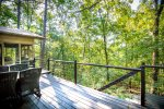 Furnished deck with quiet wooded setting