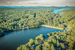 52 Majorca Drive - A great location on Lake Pineda and close to the Coronado Center and East end golf courses in Hot Springs Village lake and golf resort.