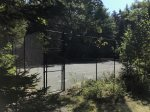 This property has its own tennis court Just across the street from the house