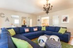 Kick Back with Family and Friends in a Super Casual Beach Mediterranean Colors Inspired Living Room with Local Photos of Local Beaches